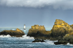 Before the storm. Lonely lighthouse in the Atlantic Ocean, high density range shot Royalty Free Stock Photography