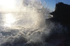 Storm. On the wave sea fight about rocks all in splashes Stock Photo