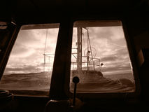 Before storm. View from fishingboat cabine before storm, sephia stock image
