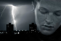 Storm. Over town with face of a beautiful women in front Royalty Free Stock Images