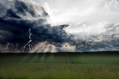 Storm. And lightning over green landscape Royalty Free Stock Images