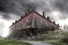 Storm. The gloomy ancient house and big clouds Royalty Free Stock Photo