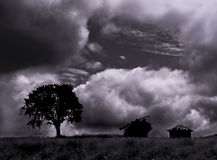 Storm....(5). Here is a tree and a house under the storm Royalty Free Stock Photography