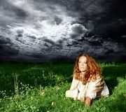 Storm. A woman on the meadow and a storm Royalty Free Stock Photography