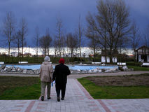 Before storm. Two old ladies leaving park  before storm Stock Image