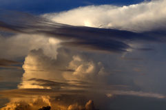 Storm. Thunderstorm building during a golden sunset in Florida Stock Photos