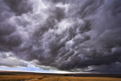 Storm. The thundercloud closes the sky above boundless plain in state of Montana. More magnificent pictures from the American and Canadian National parks you can Stock Photo