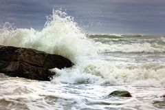 Storm. Foamy waves from a storm near the sea cliffs Stock Image