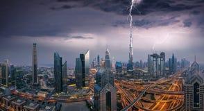Storm above Dubai city. Dubai dramatic panoramic view lightning storm. Dubai is super modern city of UAE, cosmopolitan megalopolis stock images