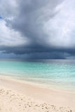 Storm above a tropical sea. A tropical rain storm approaching a sandy beach, in the Maldives Royalty Free Stock Images