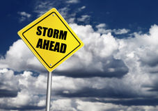 Storm ahead road sign. Over dark sky royalty free stock photos
