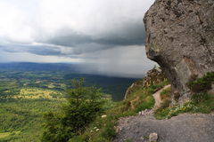 The storm is approaching. Tracking on a path to the Puy Dome top,Auvergne, France. The storm is approaching stock images