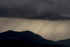 The storm is approaching as the day on the mountain ends. The storm is approaching as the day stock photo