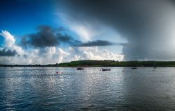 Storm approaching bay with boats moored in Youghal bay Ireland stock image