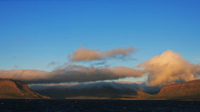 Storm approaching over a fjord in Iceland Stock Photography