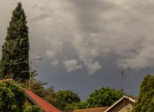 Storm clouds over residential houses stock image