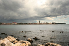 Storm approaching Porec (Parenzo) old town in Istria, Croatia. View of Porec (Parenzo) old town in Croatia, Adriatic coast, Istria region, popular touristic Royalty Free Stock Photo