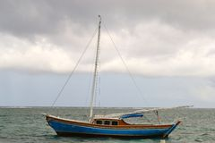 Storm approaching sailboat Stock Photos