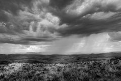 Storm aproaching at the Ibitipoca National Park. Ibitipoca National Park, Mina Gerais, Brasil – December 30, 2014: Dark stormy clouds with rain royalty free stock photography