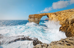 Storm the Azure Window in Gozo, Malta.  Stock Photos