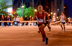 Storm the Bastille 5K Race. A runner heads towards the finish line during an evening 5K race in Milwaukee, Wisconsin, the 2015 Storm the Bastille event Royalty Free Stock Image