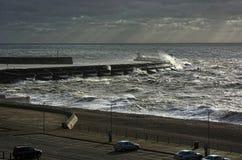 Storm batters harbor wall Royalty Free Stock Photo