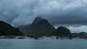 Storm in the Bay with floating boats in El Nido. 4K TimeLapse - August 2016, El Nido Palawan, Philippines. 4K TimeLapse - August 2016, El Nido Palawan stock video footage