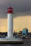 The storm begins. Vorontsov Lighthouse in Odessa, Ukraine. Vorontsov Lighthouse located at the tip of the Quarantine (now the Raid) breakwater in the port of Royalty Free Stock Image