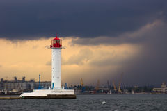 The storm begins. Vorontsov Lighthouse in Odessa, Ukraine. Vorontsov Lighthouse located at the tip of the Quarantine (now the Raid) breakwater in the port of Stock Image