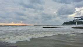 Storm on the Black Sea coast at sunset Stock Images