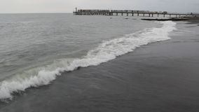 Storm on the Black sea. Foamy waves rolling on a deserted shore stock video