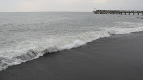 Storm on the Black sea. Foamy waves rolling on a deserted shore stock video footage