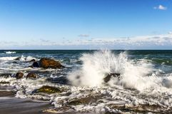 A storm in the Black Sea waves crashing against the rocks royalty free stock image