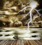 Storm. Boardwalk, sea, lightning in sky Stock Photo