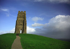 Storm brewing at Glastonbury T. Stormy clouds brewing at Glastonbury Tor Stock Photos