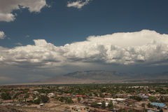 Storm Brewing over Albuquerque. Large storm brewing over Albuquerque, New Mexico, with Sandia Mountains in background royalty free stock images
