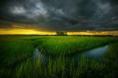 Storm Brewing Over Grass Island Stock Image