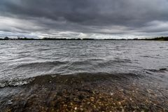 A storm brewing over a lake in Staffordshire, England Royalty Free Stock Photos