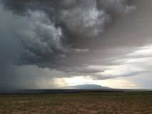 Storm brewing. There was a storm brewing in the desert over the Sandia Peak looking pretty ominous storm stock photos