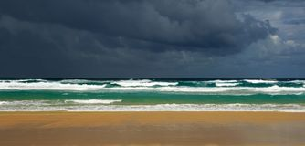 Storm Brewing. A very angry sky looms above a beautiful beach The image was taken on Fraser Island, Australia stock photography