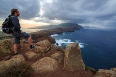 Storm cliff Madeira tourist. Tourist on the cliffs in the beautiful landscape of the east coast of the island Madeira at Ponta de Sao Lourenco nature reserve, on stock photo