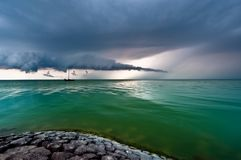 A storm cloud approaching on the IJsselmeer Stock Photos