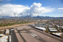 Storm Cloud. S over the McDowell Mountains from Scottsdale Airport in Arizona stock image