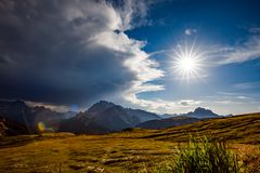 A storm cloud is coming in the sun. The beginning of the storm. Royalty Free Stock Photos