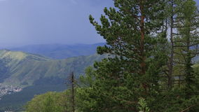 Storm cloud in the mountains. View from the top of Mount Shallow Sinyuha. stock footage