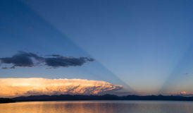 Storm Cloud Natural Searchlight Yellowstone Lake Absaroka Mountains. An unusual light points up into the sky at sunset Royalty Free Stock Photos