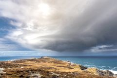 Storm Cloud over the Ocean. This is a rain cloud coming in from the ocean at Malin Head Ireland.  Malin Head is the northern most point of Ireland Royalty Free Stock Image