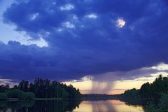 Storm cloud over the river. Storm cloud over the Siberian river Vatjegan royalty free stock photo