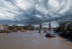 A storm cloud over The River Thames with Tower Bridge in the background stock image