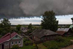 Storm cloud over the Russian village Royalty Free Stock Photos